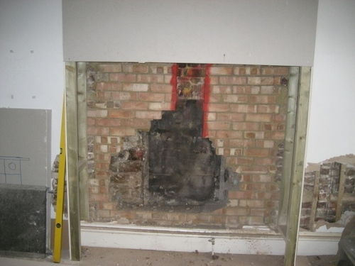 Original fire back revealed when wall was stripped.