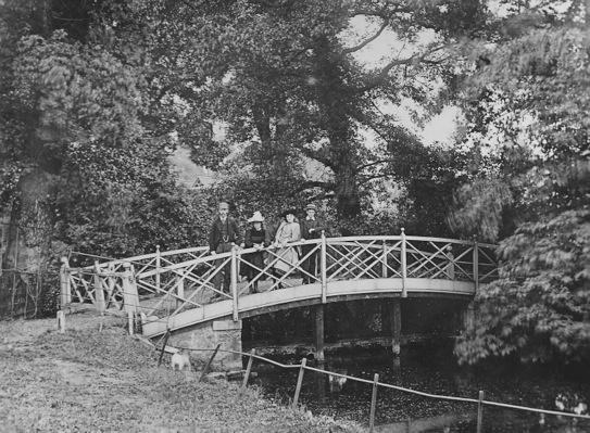 Bridge over lake in garden of Eagle House,