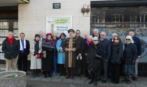 Members by the unveiled plaque