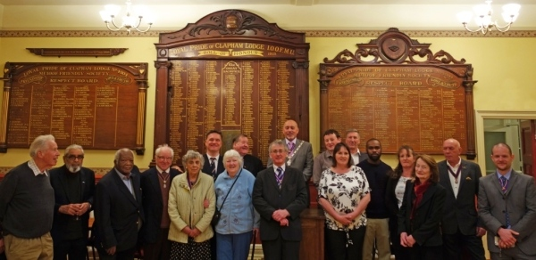 Members of the party in front of the display boards
