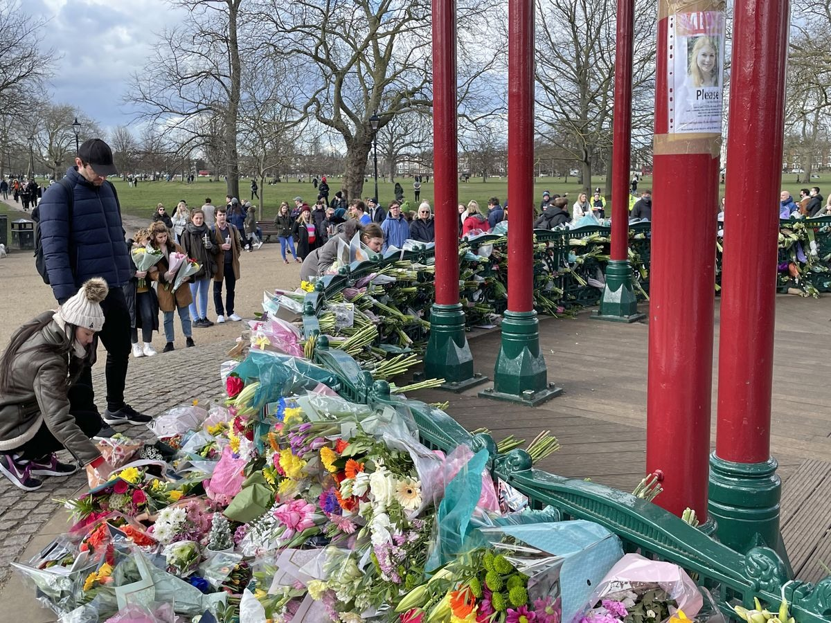 Saturday 13 March — A 'Missing' poster now overlooks memorial flowers