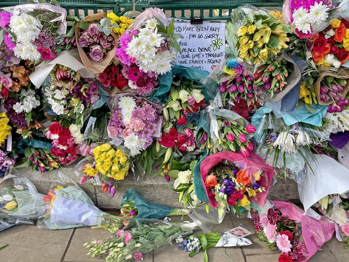 Saturday 13 March — A tender message seen amid the bouquets