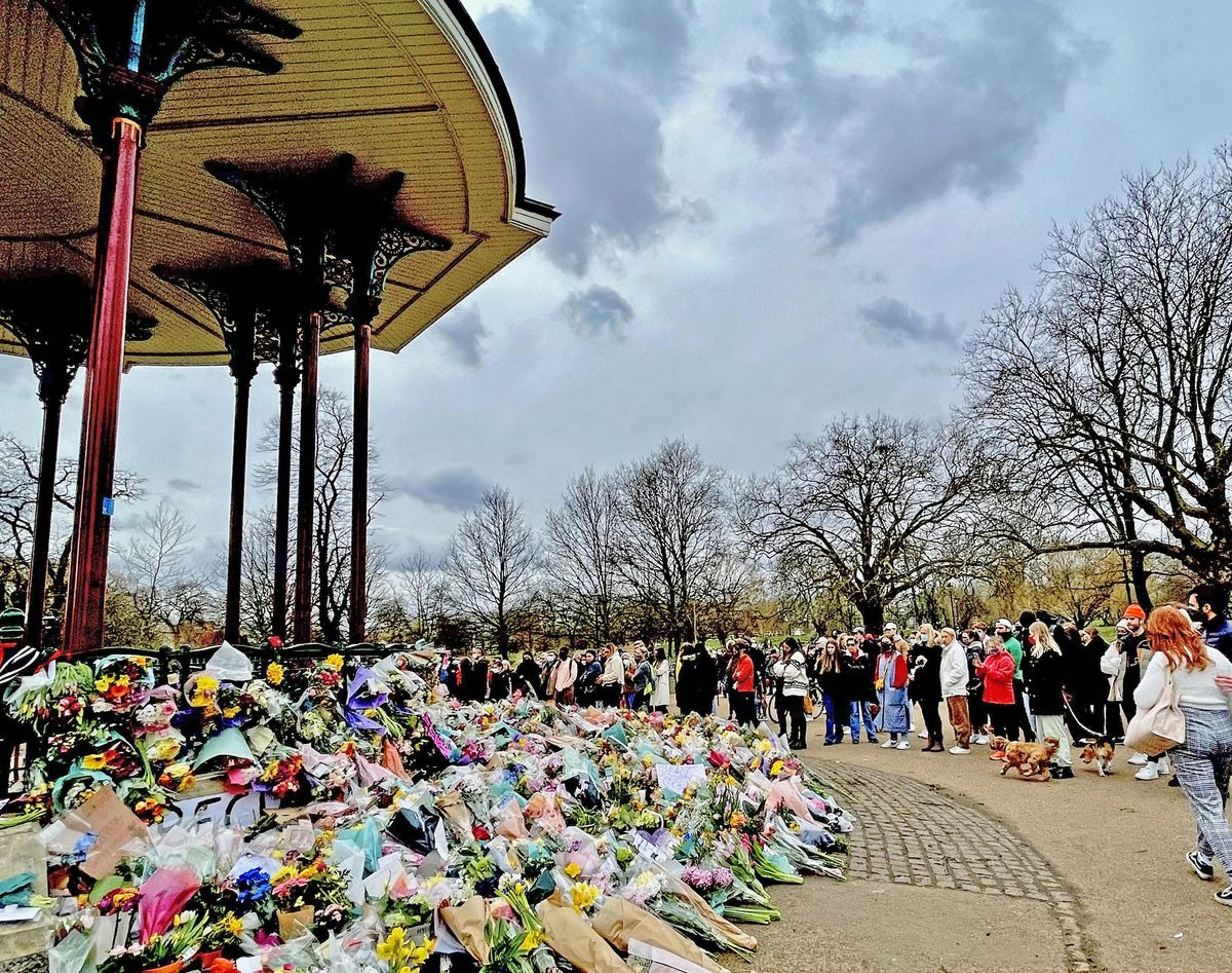 Sunday 14 March — A reverential crowd rings the Bandstand in disbelief