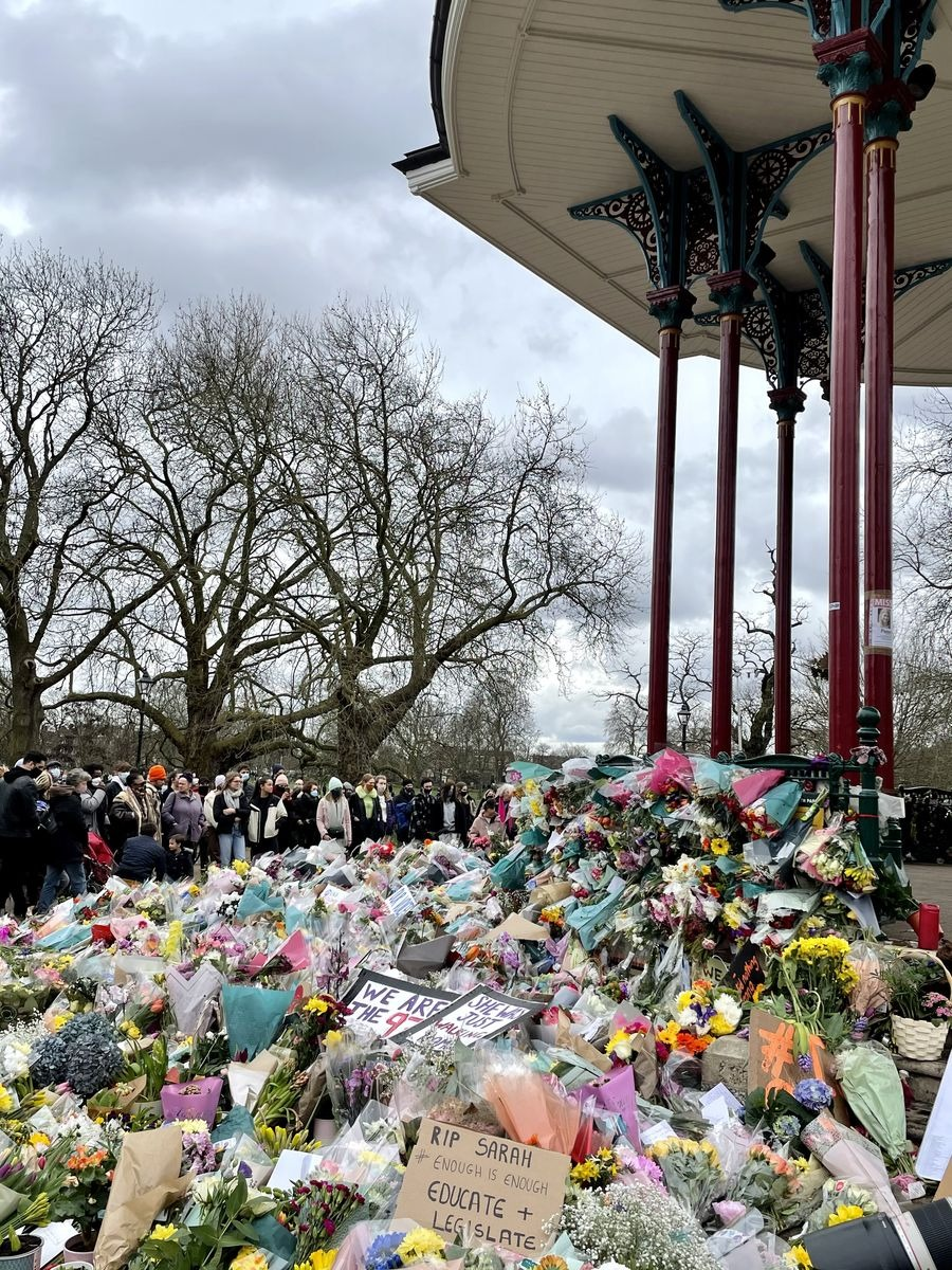 Sunday 14 March — As dusk descends the floral tributes grow deeper